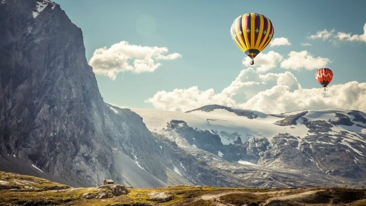 Hot Air Balloon Over the Mountain Wallpaper