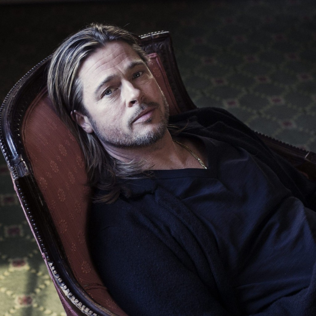 Brad Pitt Sitting On Chair Wallpaper for Apple iPad