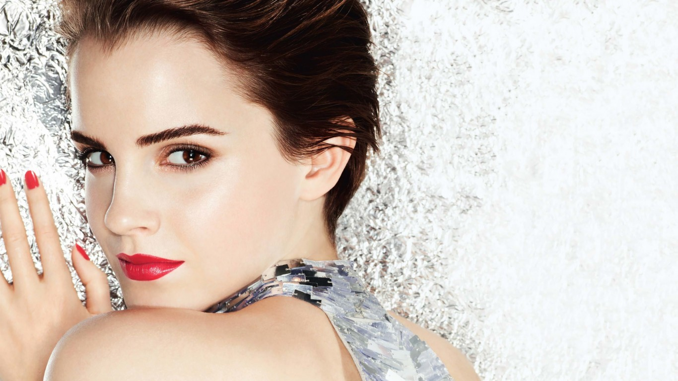 Emma Watson Posing Wallpaper for Desktop 1366x768