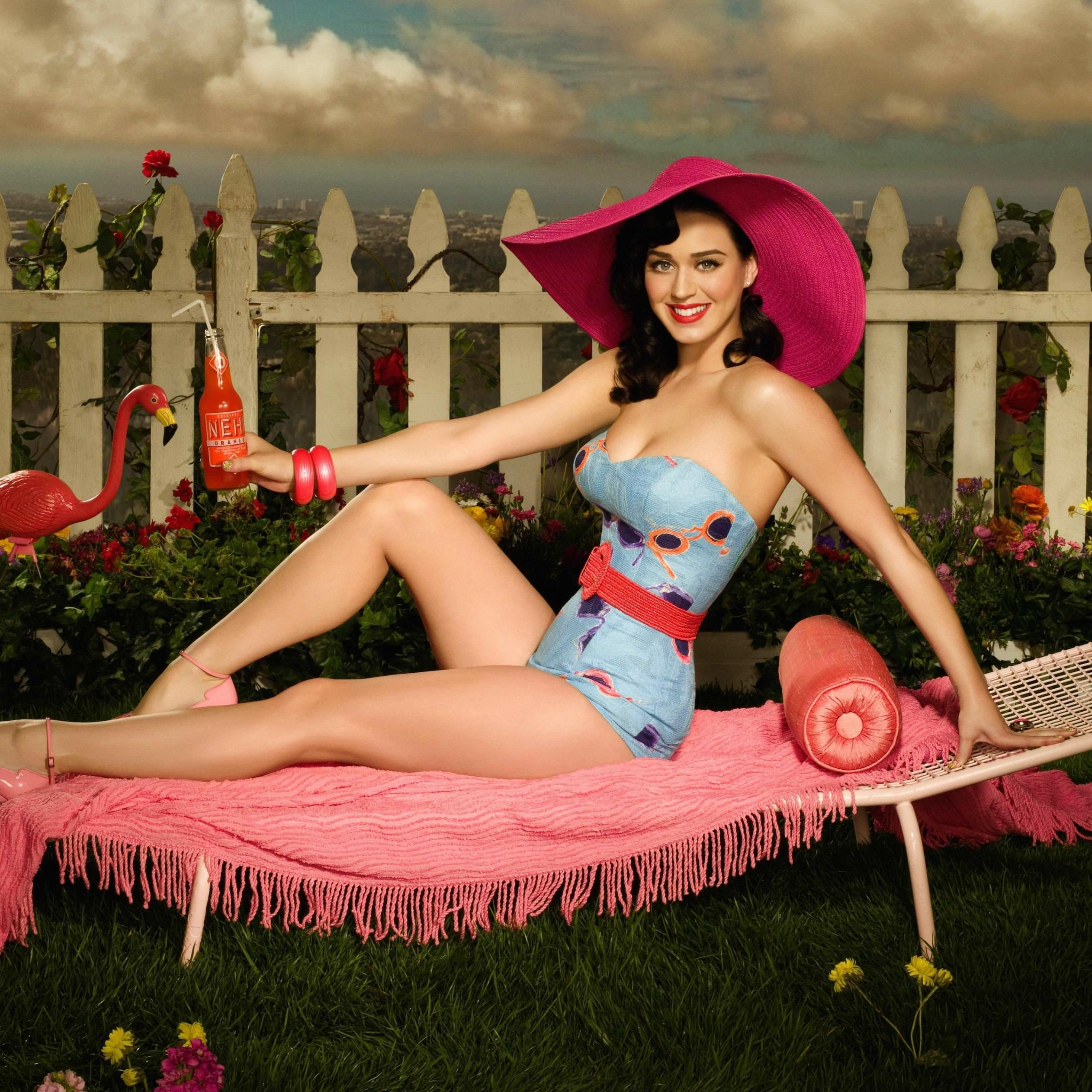 Katy Perry Lying On Chair Body Figure Wallpaper for Apple iPad Air