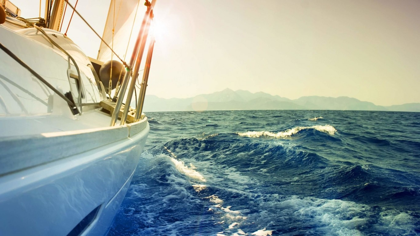 Yacht Sailing Downwind at Sunset Wallpaper for Desktop 1366x768