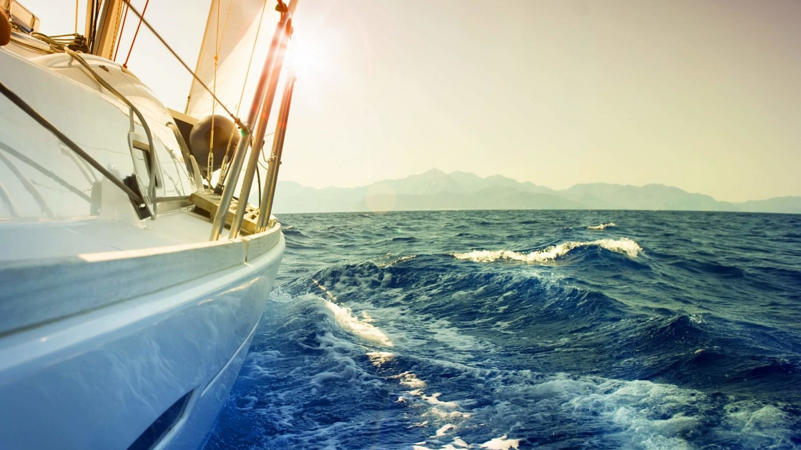 Yacht Sailing Downwind at Sunset Wallpaper for Desktop 1600x900